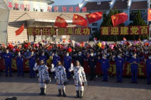 A Chinese spaceship carrying a three-person crew docked with China's new space station